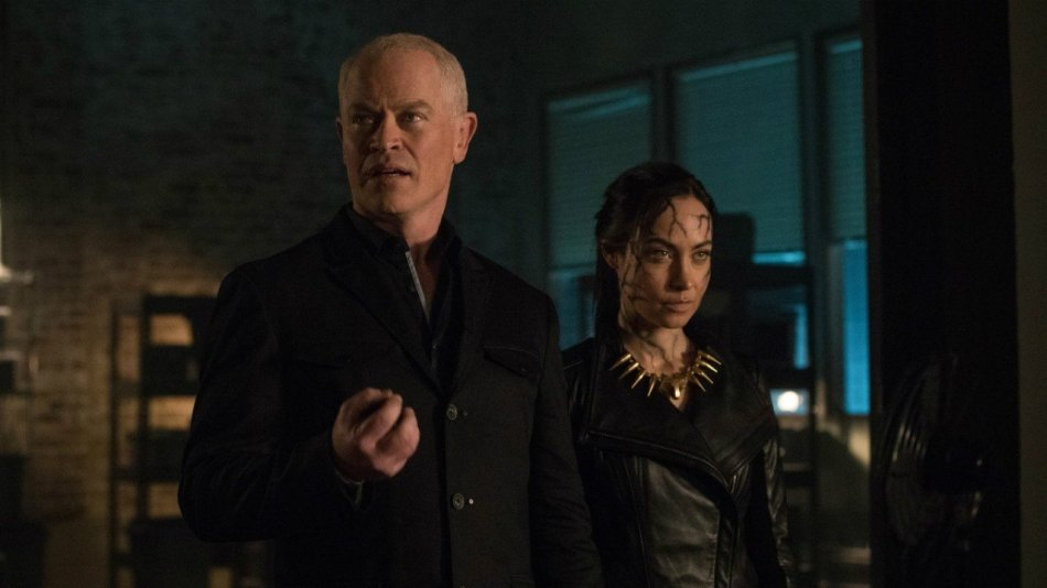 Neal McDonough and Courtney Ford as Damien and Nora Darhk Courtesy of The CW